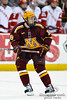Minnesota winger Nick Larson (18) looks for a pass during the game between the Minnesota Golden Gophers and the Wisconsin Badgers at the Kohl Center in Madison, WI.  Minnesota defeated Wisconsin 5-2.   Mandatory Credit: John Rowland / Southcreek Global