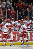 Wisconsin defenseman Jake Gardiner (19) is congratulated by the bench after scoring a 2nd period goal during the game between the Minnesota Golden Gophers and the Wisconsin Badgers at the Kohl Center in Madison, WI.  Minnesota defeated Wisconsin 5-2.   Mandatory Credit: John Rowland / Southcreek Global