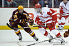 Wisconsin center Podge Turnbull (8) tries to break free from Minnesota center Erik Haula (19) during the game between the Minnesota Golden Gophers and the Wisconsin Badgers at the Kohl Center in Madison, WI.  Minnesota defeated Wisconsin 5-2.   Mandatory Credit: John Rowland / Southcreek Global