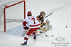 Minnesota goalie Kent Patterson (35) makes a save on a breakaway by Wisconsin winger Tyler Barnes (7) during the game between the Minnesota Golden Gophers and the Wisconsin Badgers at the Kohl Center in Madison, WI.  Minnesota defeated Wisconsin 5-2.   Mandatory Credit: John Rowland / Southcreek Global