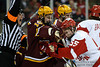 Minnesota center Erik Haula (19) and Wisconsin defenseman John Ramage (55) fight during the game between the Minnesota Golden Gophers and the Wisconsin Badgers at the Kohl Center in Madison, WI.  Minnesota defeated Wisconsin 5-2.   Mandatory Credit: John Rowland / Southcreek Global