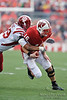Wisconsin quarterback Scott Tolzien (16) is brought down by Indiana linebacker Brandon McGhee (39) during the game between the Indiana Hoosiers and the Wisconsin Badgers at Camp Randall Stadium, Madison, Wisconsin.  Wisconsin defeated Indiana 83-20.  Mandatory Credit: John Rowland / Southcreek Global