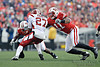 Wisconsin defensive lineman David Gilbert (11) brings down Indiana running back Antonio Banks (27) during the game between the Indiana Hoosiers and the Wisconsin Badgers at Camp Randall Stadium, Madison, Wisconsin.  Wisconsin defeated Indiana 83-20.  Mandatory Credit: John Rowland / Southcreek Global