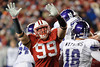 Wisconsin defensive end J.J. Watt (99) pressures Northwestern quarterback Evan Watkins (18), forcing an interception during the game between the Northwestern Wildcats and the Wisconsin Badgers at Camp Randall Stadium, Madison, Wisconsin.  Wisconsin defeated Northwestern 70-23.  Mandatory Credit: John Rowland / Southcreek Global