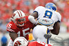 Wisconsin linebacker Culmer St. Jean (15) makes a tackle on San Jose State running back Brandon Rutley (9) during the game between the Wisconsin Badgers and the San Jose State Spartans at Camp Randall Stadium in Madison, WI. Wisconsin defeated San Jose State 27-14. Mandatory Credit: John Rowland / Southcreek Global