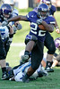 Northwestern running back Treyvon Green (22) runs through a hole during the NCAA football game between the Northwestern Wildcats and the Eastern Illinois Panthers at Ryan Field in Evanston, IL.  Northwestern defeated Eastern Illinois 42-21.