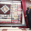 "Chancellor Charlie Nelms and Carolyn Green, granddaughter of James Shephard, unveil a commemorative quilt on Thursday, April 29, 2010 at Shepard Library.  The commemorative quilt titled ""Soaring on the Legacy"" is more than 10 feet long and 7 feet tall and includes photo transfers of historic images of the university."