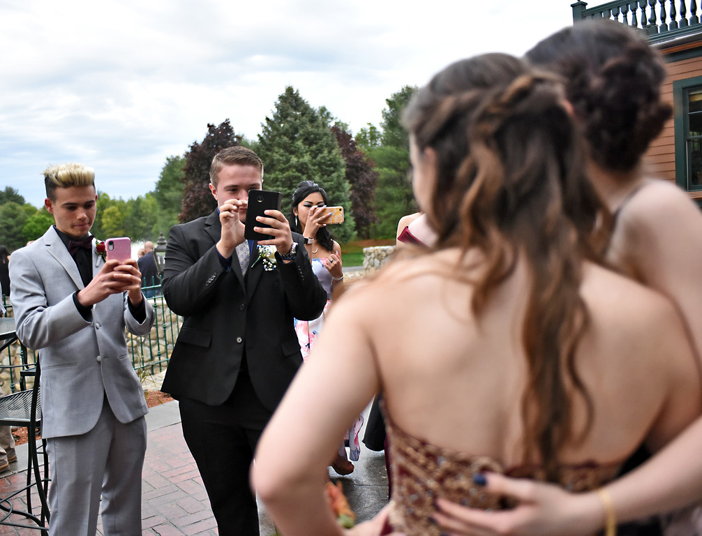. Taking photos of their prom dates is L-R, Cameron Michel 18 of Dracut, and Justyn Lake, their dates Katherine Aste 17 (Justyn\'s date) and Erin Kunze 16 of Chelmsford (Cameron\'s date). SUN/David H. Brow