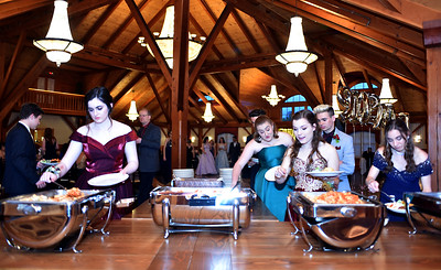 NDA prom goers hit the food line at Tewksbury CC. SUN/David H. Brow