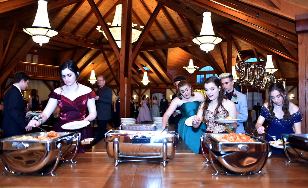 . NDA prom goers hit the food line at Tewksbury CC. SUN/David H. Brow