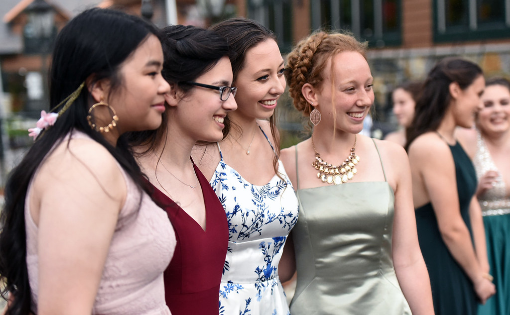 . Posing for lots of photos for keepsakes of their prom are NDA students L-R, Anoutsa Latsapanya 17 of Lowell, Elena Murguia 17 of Hollis NH, Katie Curran 18 of Lowell, and Annika Hanson 17 of Billerica. SUN/David H. Brow
