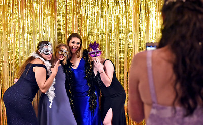 Like a scene from Mardi Gras at the NDA prom is L-R, Emma Hanrahan 17 of Westford, Ailis Peterson 17 of Westford, Lindsey Hanrahan 18 , Natalie Kelleher 18 of Lowell, and taking photos is Jillian Wright 18 of Nashua NH. SUN/David H. Brow