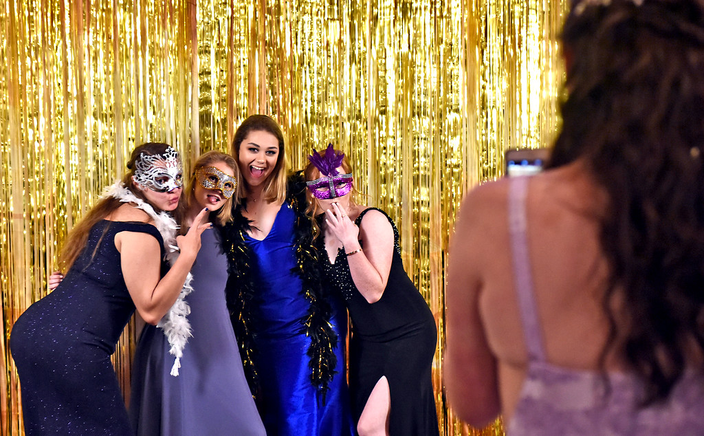 . Like a scene from Mardi Gras at the NDA prom is L-R, Emma Hanrahan 17 of Westford, Ailis Peterson 17 of Westford, Lindsey Hanrahan 18 , Natalie Kelleher 18 of Lowell, and taking photos is Jillian Wright 18 of Nashua NH. SUN/David H. Brow