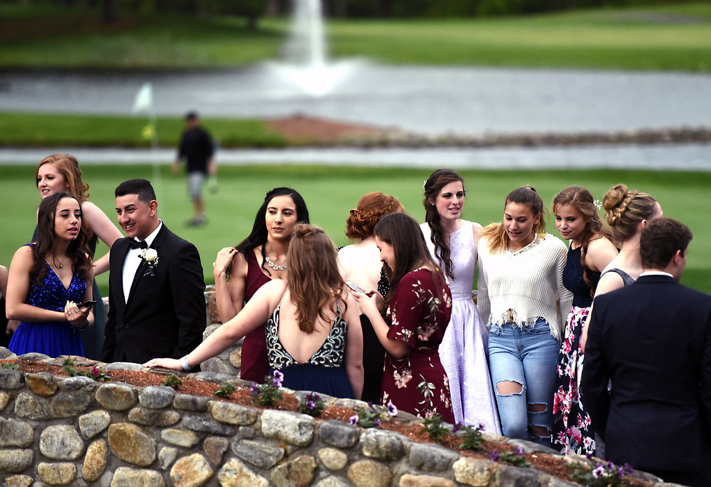 . NDA students and their friends and dates gather at the Tewksbury CC for their prom. SUN/David H. Brow