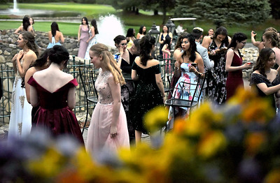Scene through the window at Tewksbury CC of the NDA prom students gather outside for phoros and meet and greets. SUN/David H. Brow