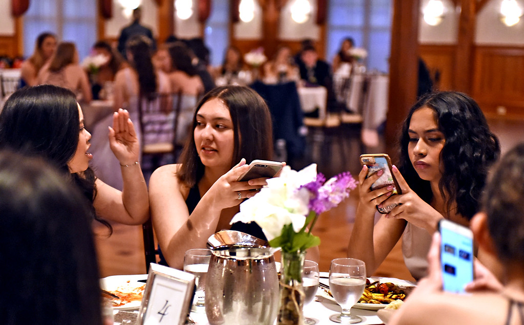 . Armed with their cell phones/cameras, are NDA students at their prom, L-R, Uyen Ha 16, Amber Bonner 17 and Ayana Nangle 17 all from Lowell. SUN/David H. Brow