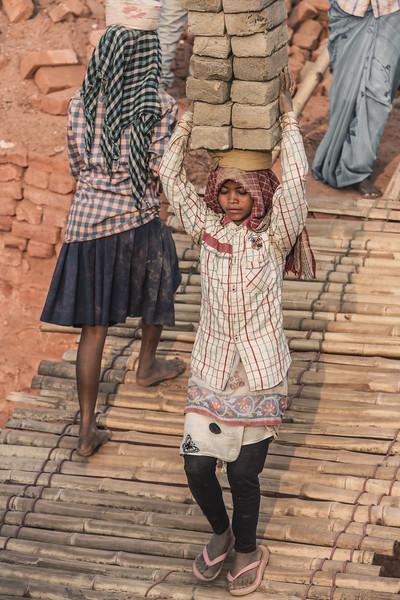 Under the burden of bricks