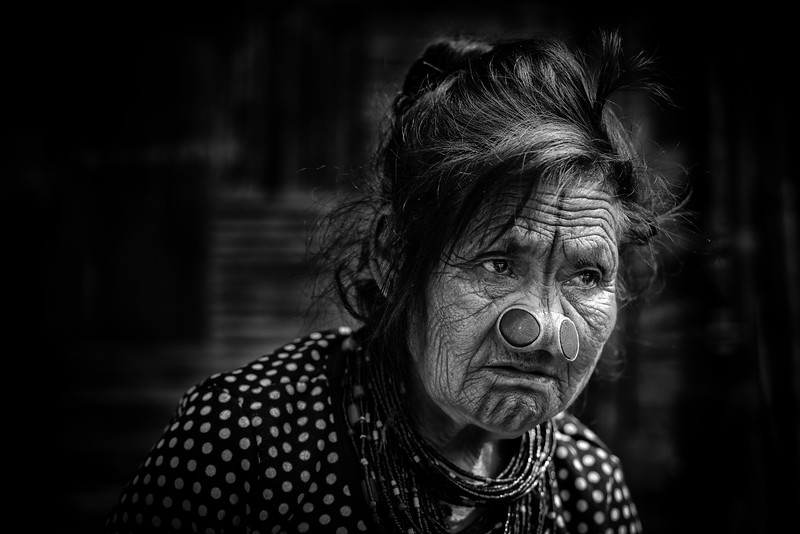 Apatani tribeswoman with plugs, Ziro