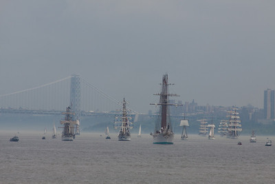 Tall ships being led southbound by Juan Sebastian de Elcano from Spain.   The New York side tower of the George Washington Bridge in the background.