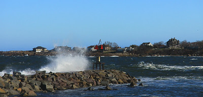 A breakwater at Rockport Mass. harbor  on a mid-November day - water & wind in motion.