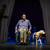 Therapy dog named Apple walks out on stage alongside guest speaker Larry Brennan who is an alumni of NEADS program in front of  NEADS 2016 fall graduating class at Monty Tech in Fitchburg on Sunday. Sentinel & Enterprise photo/Jeff Porter