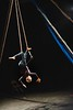 KELLY FLETCHER, REFORMER CORRESPONDENT -- Susan Murphy, an aerialist from Georgia, recites a poem about aging while she performs on the dance trapeze during NECCA's 10th annual Circus Spectacular fundraising show at Latchis Theater on Friday night.