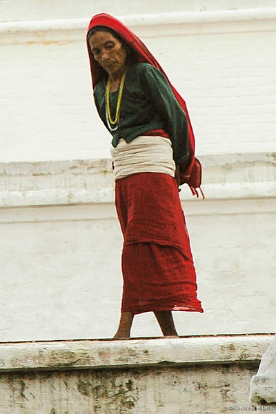 Woman with Red Scarf<br /> Boudhanath Stupa<br /> Kathmandu Valley