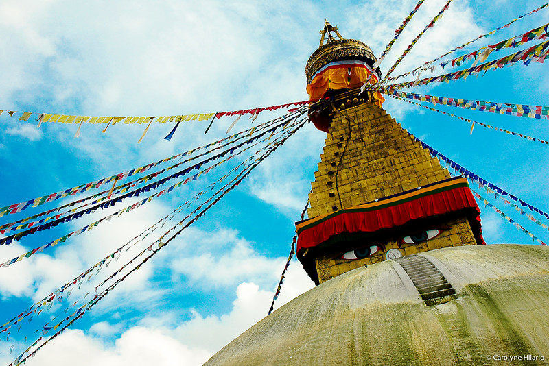 "Stupa at Boudhanath<br /> Kathmandu Valley<br /> <br /> ""This very imposing stupa is believed to house some of the remains of previous great sages and the bones of Buddha.  Believers walk in a clockwise direction around the stupa to pay their respects and have their wishes granted. It is also believed that walking around in an anti-clockwise direction is disrepectful although you can see foreigners doing just that maybe due to the fact that they do not know better or are just plain ignorant, so they are not guilty... Gurus (Buddhist teachers) will tell you to walk around the stupa 7 times if you wish to have your desires granted.  Each round will take about 5 to 10 mintues depending on your speed or the crowd that are always present at any time of the day especially during the Buddhist festive season such as Buddha's birthday etc."""