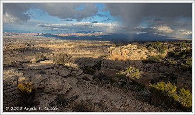 An early spring storm hits the east side of the Grand Valley as seen from near Serpent's Trail, Colorado National Monument, Grand  Junction, Colorado