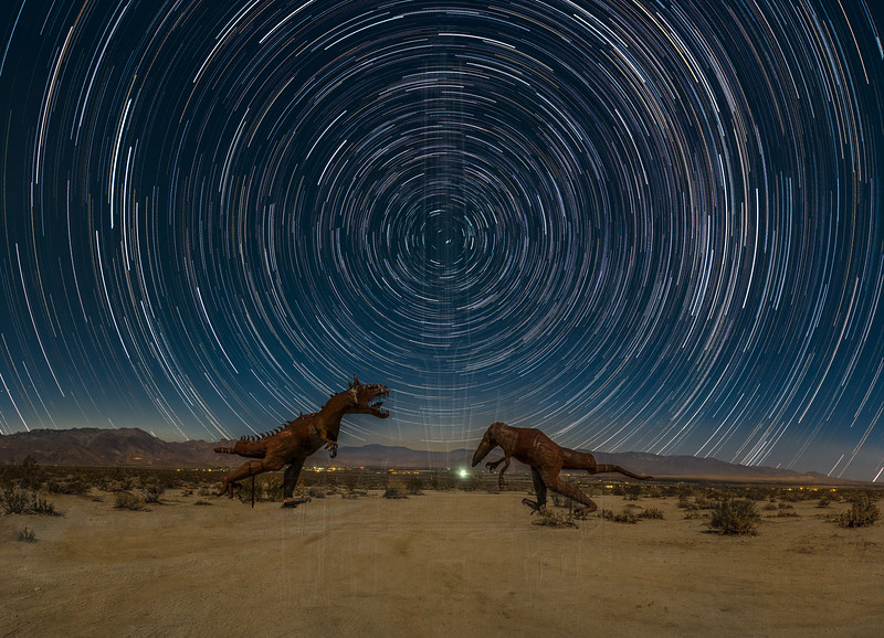 A composit of T Rex in the moonlight with star trails.  The star trails were shot at Fossil Falls.