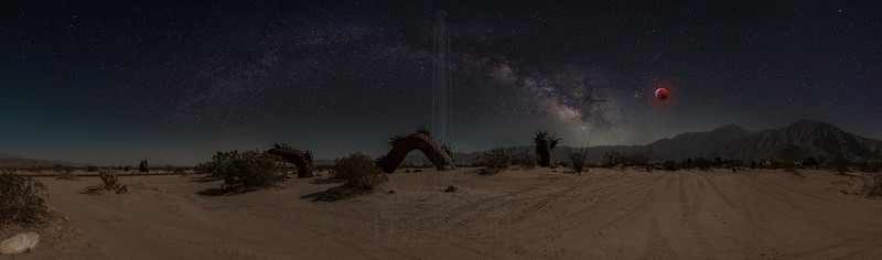 Composite of the sea serpent panorama with the Milky Way arch shot at Red Rock and the eclipsed Moon shot at Elysian Park north of downtown LA.  The placement of the moon next to Antares is accurate, but the Milky Way core would have been more vertical during the eclipse.