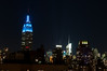 Empire State Building, blue tonight, and the Bank of America Building further north.