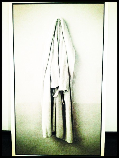 "The Bathrobe, by Sophie Calle<br /> Everyday Epiphanies<br /> The MET<br /> <br /> ""I was eighteen years old. I rang the bell. He opened the door. He was wearing the same bathrobe as my father. A long white terrycloth robe. He became my first love. For an entire year, he obeyed my request and never let me see him naked from the front. Only from the back. And so, in the morning light, he would get up carefully turning himself away, and gently hiding inside the white bathrobe. When it was all over he left the bathrobe behind with me."""