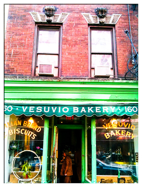 "Vesuvio Bakery<br /> Soho<br /> <br /> ""The Vesuvio Bakery at 160 Prince Street has long presented one of New York City's iconic storefronts. The bakery opened in 1920 and was owned by Anthony Dapolito, who delivered Vesuvio bread on his bicycle as a child, for many years before his death in 2003.  The space is currently Birdbath Bakery.  To neighborhood outsiders, it still looks like Vesuvio's… the Birdbath sign is small and stashed at the lower left corner of the left window""."