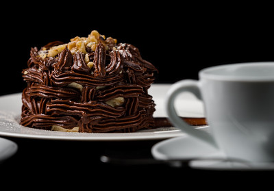 Kiev cake with nuts and chocolate. Close-up photography in a restaurant. Sweet delicious dessert of Russian cuisine.
