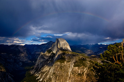 Rainbow above Half Dome, Yosemite National Park. View from Glacier Point.