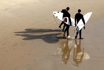 Surfers at Hermosa Beach, CA.
