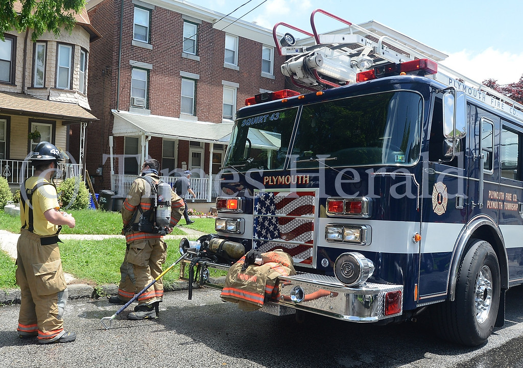 . Fire fighters are investigating a fire on E 8th Street in Conshohocken.  Friday, May 30, 2014.  Photo by Adrianna Hoff/Times Herald Staff.
