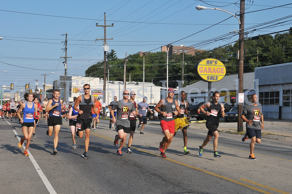 . The runners begin the race at the 9/11 Heroes Run on Main Street in Norristown.  Sunday, September 8, 2013.  Photo by Adrianna Hoff/Times Herald Staff.