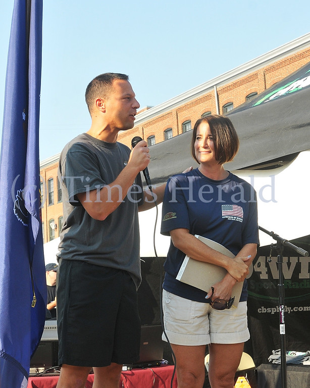 . Montgomery County Commisioner Josh Shapiro and District Attorney Risa Vetri Ferman thank the supporters for the 911 Heroes Run.  Sunday, September 8, 2013.  Photo by Adrianna Hoff/Times Herald Staff.