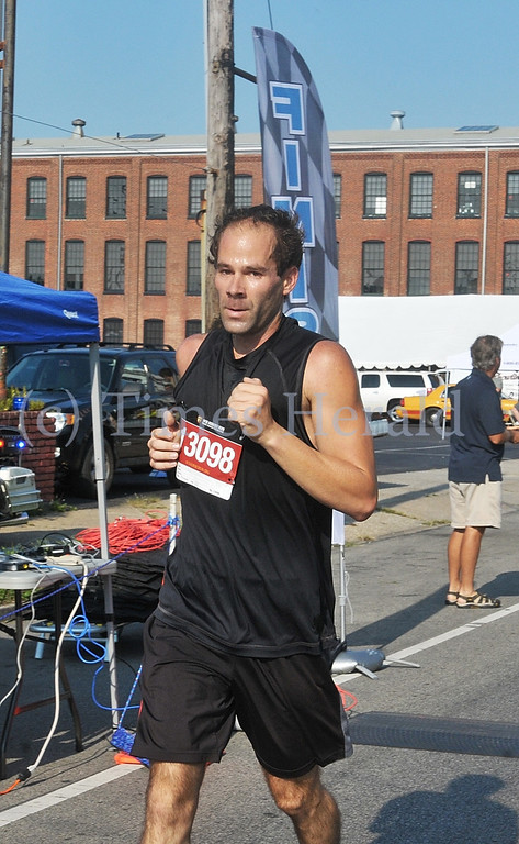 . Michael Popp is the first to cross the finish line for the 9/11 Heroes Run in Norristown.  Sunday, September 8, 2013.  Photo by Adrianna Hoff/Times Herald Staff.