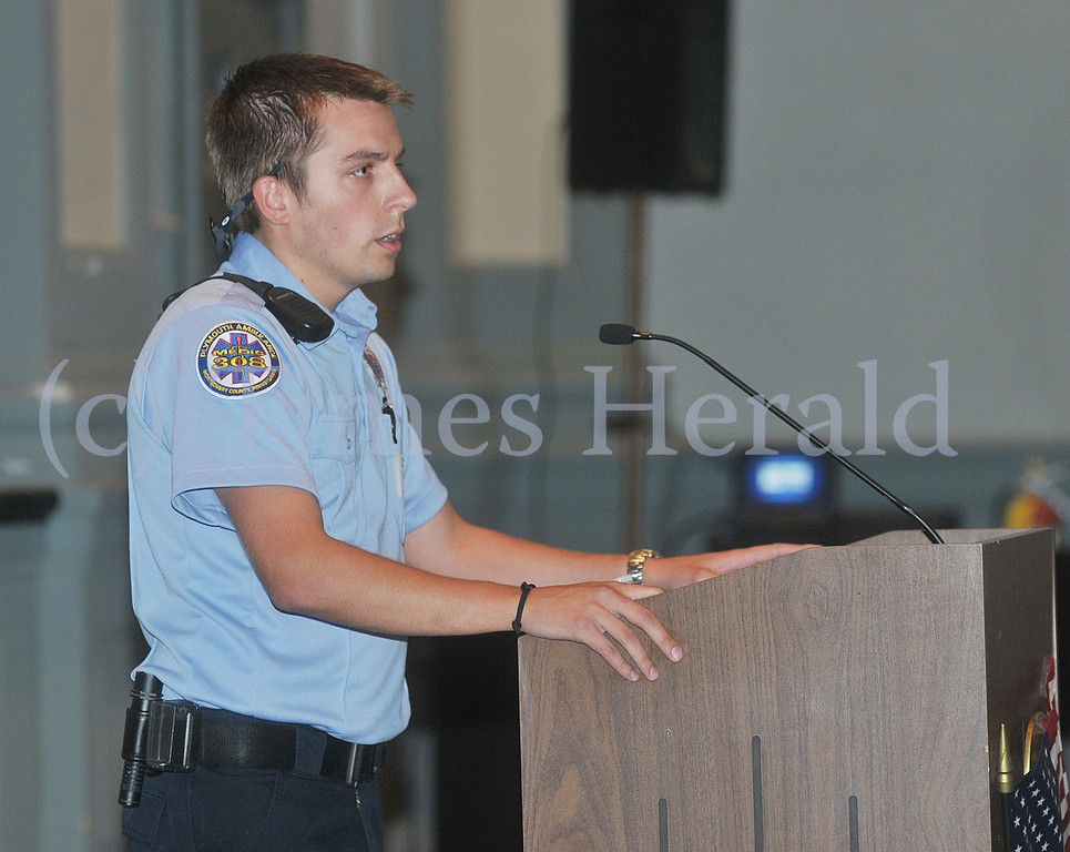 . Plymouth Ambulance\'s Medic Colin Hunsicker talks to students about the importance of September 11th.  Wednesday, September 11, 2013.  Photo by Adrianna Hoff/Times Herald Staff.
