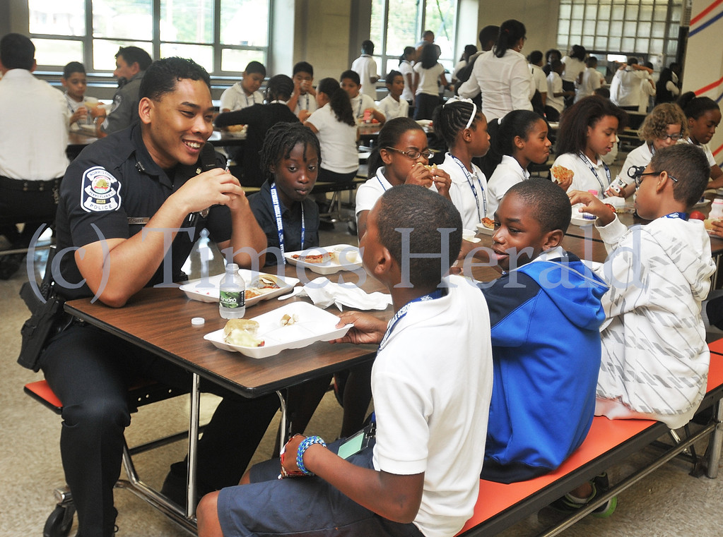 . Norristown Officer Steven Sowell speaks to fifth graders during lunch at Stewart Middle School.  Wednesday, September 11, 2013.  Photo by Adrianna Hoff/Times Herald Staff.