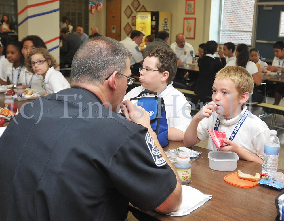 . Rocco Piergrossi and Jacob Scott get a chance to chat with Lt. Rich Clowser of the Norristown Police Department.  Wednesday, September 11, 2013.  Photo by Adrianna Hoff/Times Herald Staff.