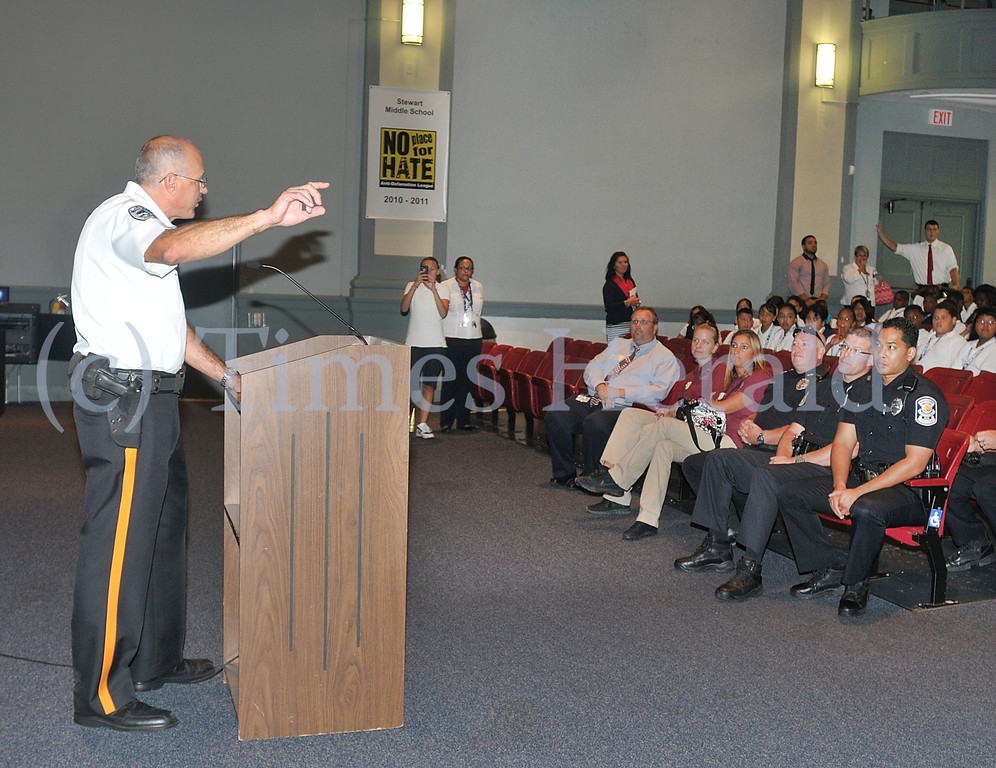. West Norriton Chief of Police Dale Mabry talks to fifth graders in the Stewart Middle School Auditorium and explains some of the police officers duties.  Wednesday, September 11, 2013.