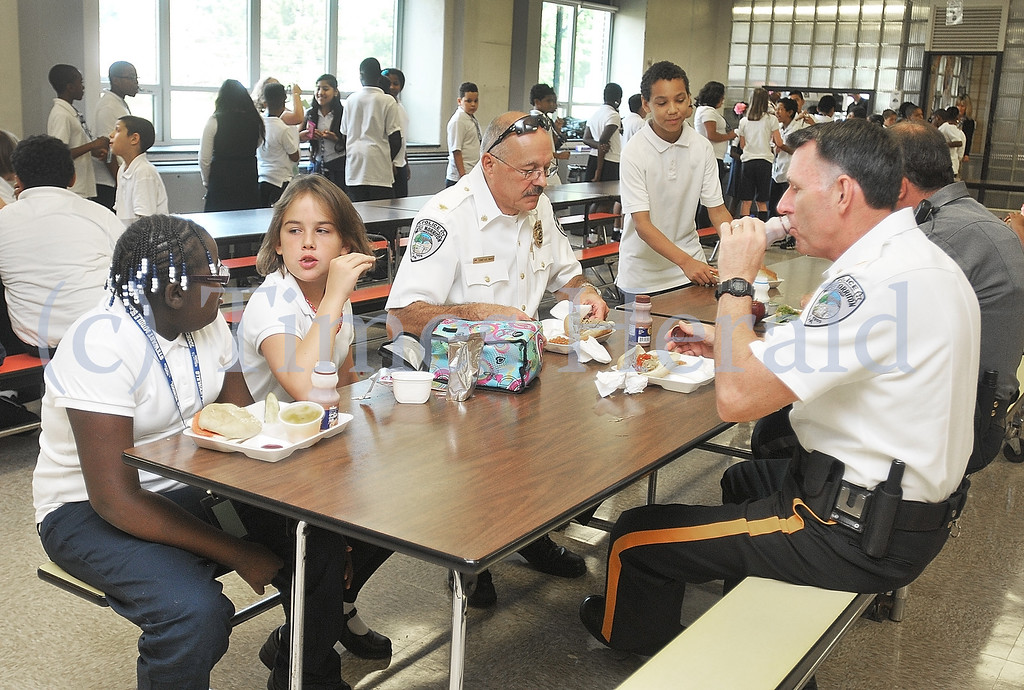. West Norriton Chief of Police Dale Mabry and Deputy Chief Mike Kelly chat with Stewart Middle School fifth graders Kendra Tilman and Brenda Lynn Boyle.  Wednesday, September 11, 2013.  Photo by Adrianna Hoff/Times Herald Staff.