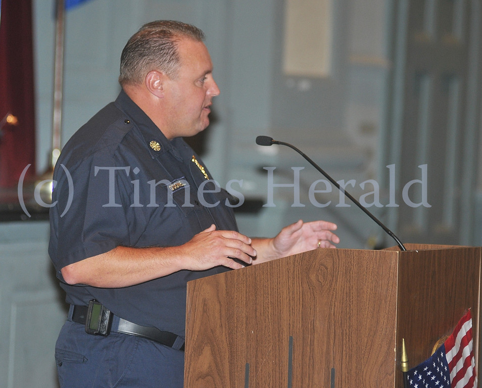 . Norristown Fire Chief Tom O\'Donnell talks to kids about both full-time and volunteer parts of the Norristown Fire Department.  Wednesday, September 11, 2013.  Photo by Adrianna Hoff/Times Herald Staff.