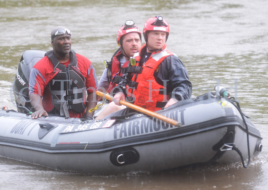 . A man riding a jet ski was rescued by emergency personnel on the Schyulkill River.  Norristown, June 13, 2014.  Photo by Adrianna Hoff/Times Herald Staff.