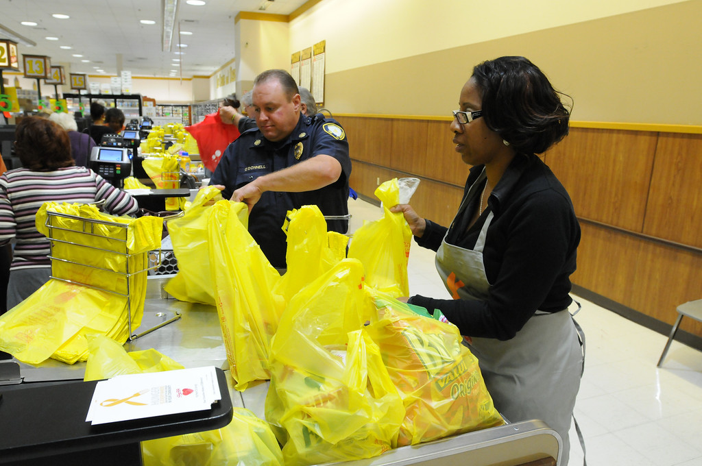 . Area civic and professionals volunteer to bag food during the East Norriton Shop Rites Bag for Hunger Sept. 18, 2013. Photo by Gene Walsh / Times Herald Staff