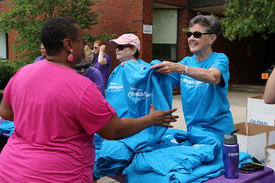 Volunteers sell shirts and water bottles to participants and their families in support of Einstein Medical Center Montgomery's Cancer Survivorship Program Saturday, May 30, 2015. Photos for The Times Herald by Alexis Primavera.